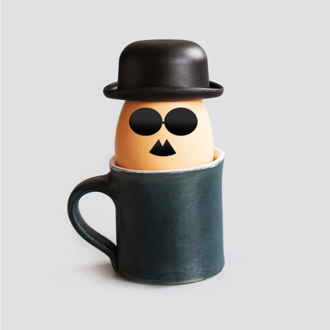 Hipster breakfast egg characters with mustache, beard, black bowler hat and glasses. Creative design holiday poster eggs cups. drawn gentleman faces vintage style. gray background.